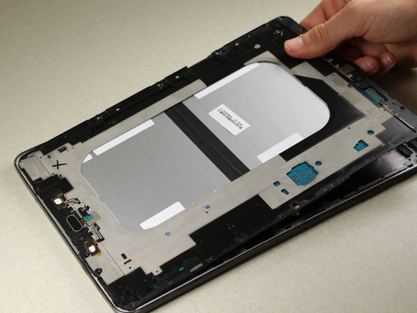Lift up the central panel starting from one corner to separate it from the rest of the device.