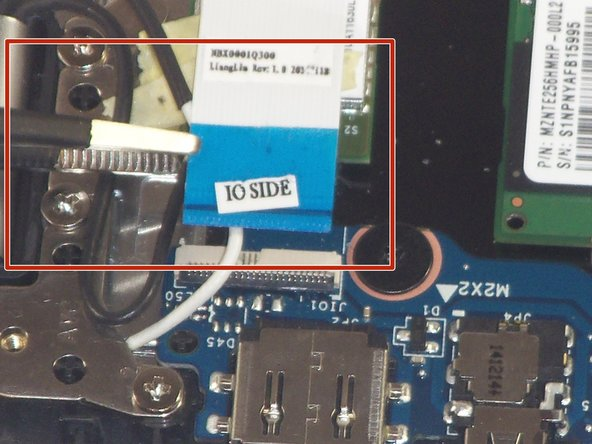 "Use a pair of tweezers to disconnect the ZIF connector securing the ""IO Side"" of the USB ribbon cable. Gently lift up the black tab on the connector and the ribbon cable should come free."
