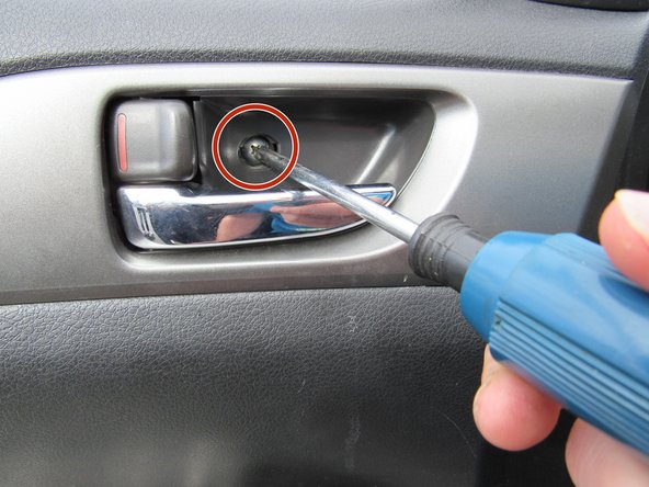 "Use your Phillips screwdriver to unscrew the 8x3/4"" Phillips screw by the upper door handle."