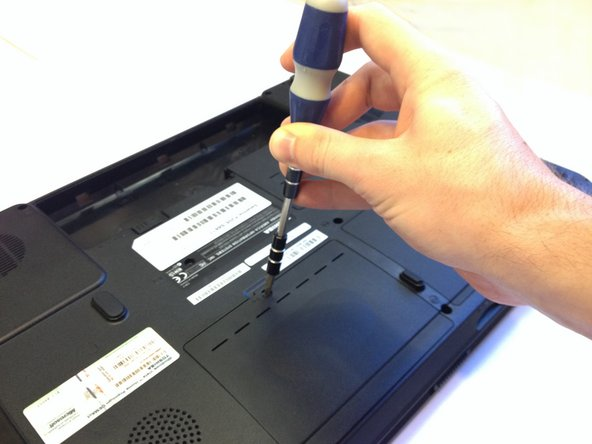 Use a #1 Phillips screwdriver to take out the 8mm Phillips #1 screw holding the hard drive panel on.