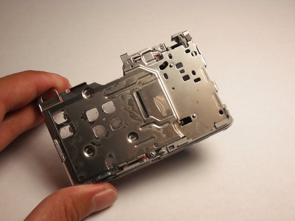Remove the bottom part of the camera (where the battery is inserted into).