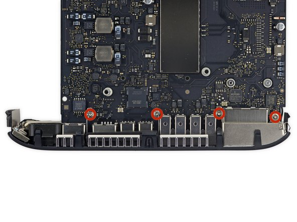 Remove the four 2.7 mm T6 Torx screws holding the I/O bezel to the logic board.