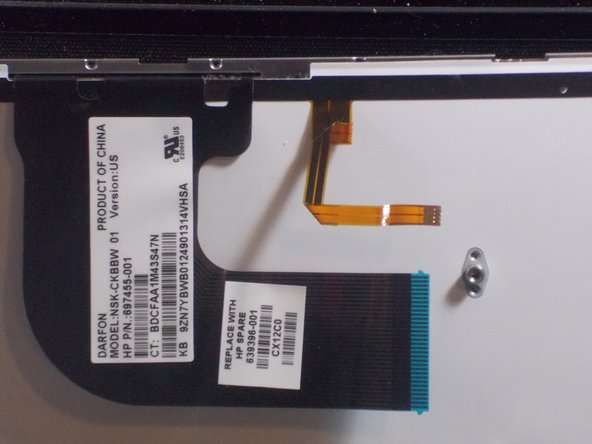 Lift the keyboard out of the device and carefully remove ribbon cables.
