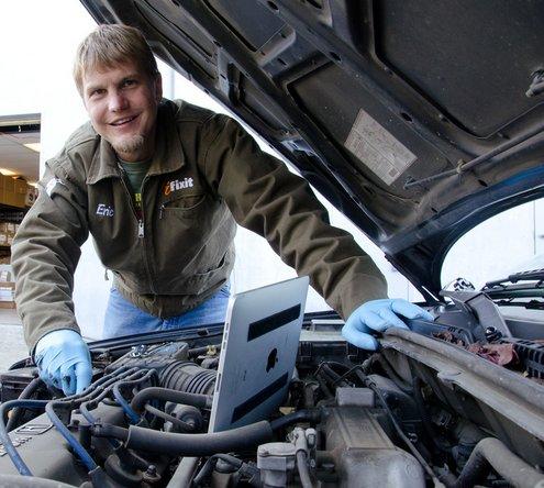 Using the repair manual on the iPhone app to repair a car