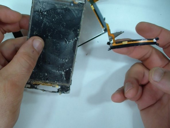 Remove the flex cable from the old touch screen if you need.