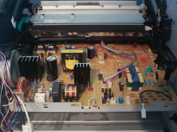 Remove the feed plate from over the main board.