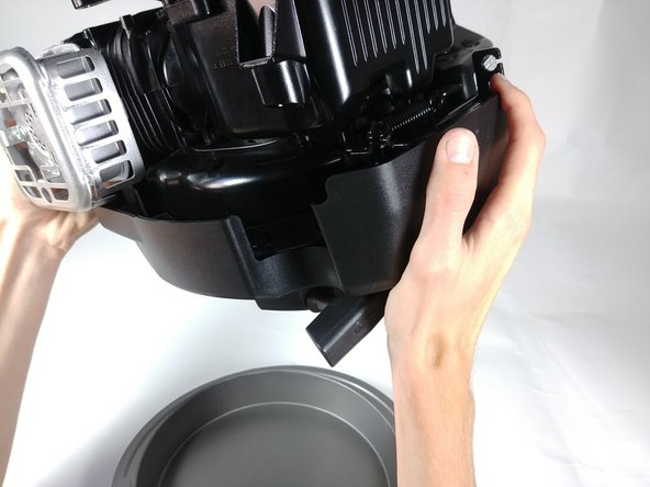 Place your Drain Pan below the engine and flip the engine over so that the used oil pours out of the Dipstick spout.