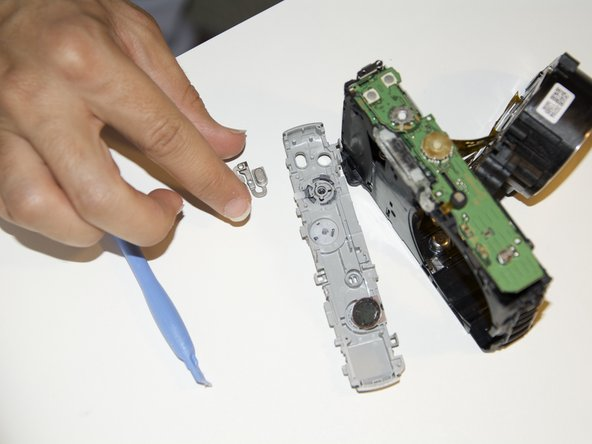 After removing the top cover of the camera, you will be able to easily remove the power button with your hand.