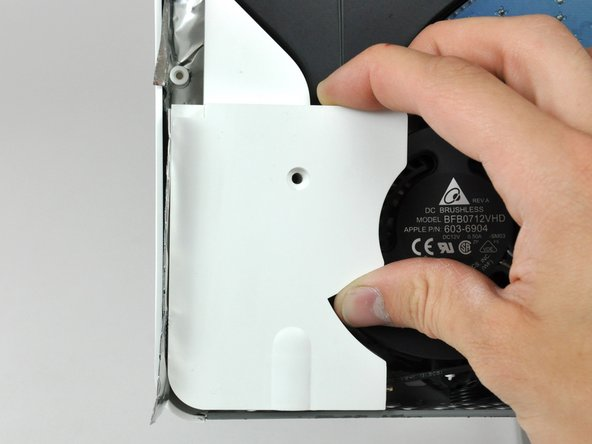 Pull the left speaker out of the rear case.