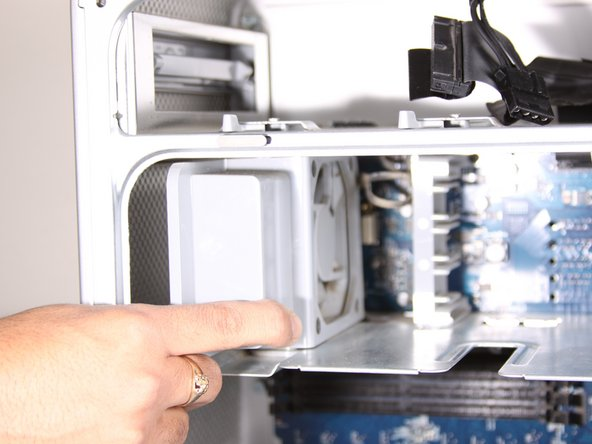 Image 1/1: Pull the fan straight out from its slot. You will need to remove two cables from the motherboard.