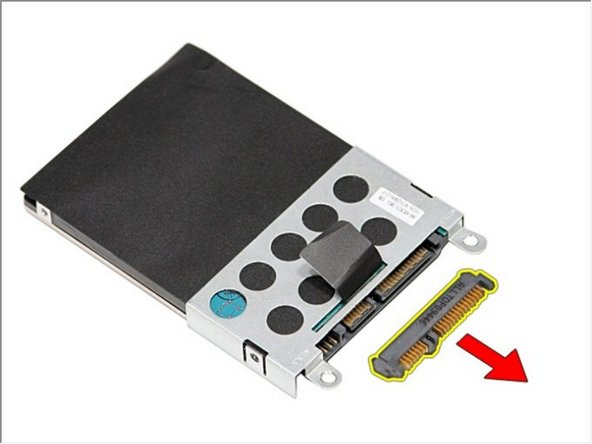Remove the hard-drive adapter from the hard-drive assembly.