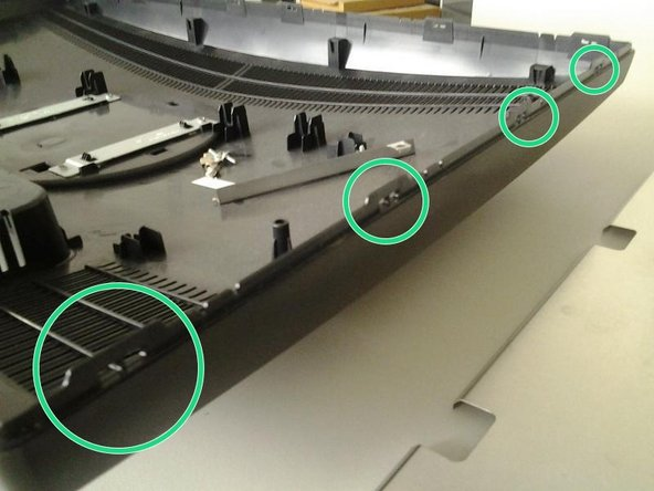 Remove the display stand by removing the two screws on the round plate on the backside of the monitor