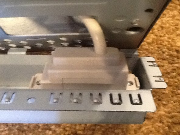 Remove the two screws on the audio box. Then pull it out and set the case aside.
