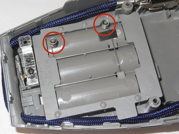 Inspect the two small springs on the back of the battery compartment.
