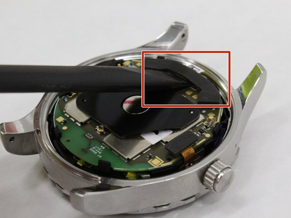Utilize tweezers or a spudger or your fingers to pull the black wire connector from the motherboard.