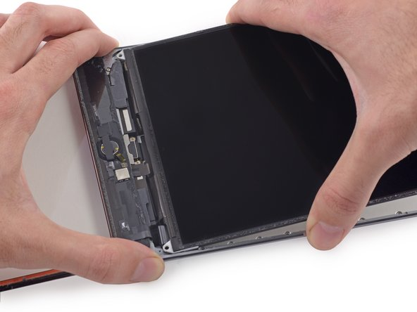 Hold the LCD with one hand, and the rear body of the iPad with the other.