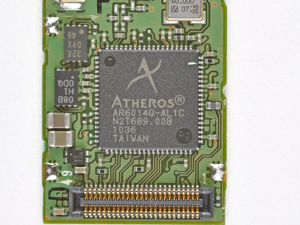 The back of the board has a sticker labeled Mitsumi DWM-W028, but at its heart lies an Atheros AR6014 IC for 802.11 b/g connectivity.