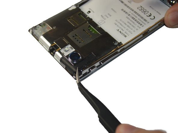 Repeat the same steps to remove the black plates located at the top left, and top right of the phone.