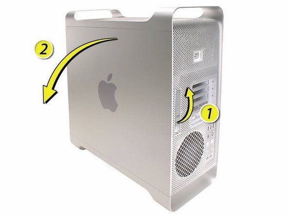 1) Hold the side access panel and lift the latch on the back of the computer.