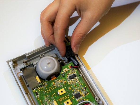 Carefully remove the microphone from the casing by pulling away from the device.