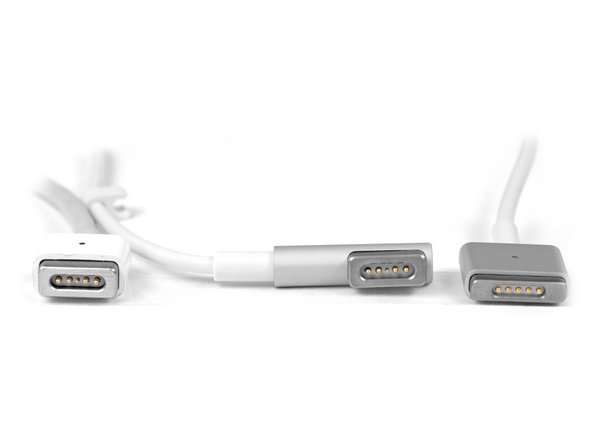 As you can see, the new MagSafe 2 connector (bottom) is much thinner and wider than its predecessor. This is pretty significant, because the thickness of Apple's devices seems to be limited only by the size of their ports.