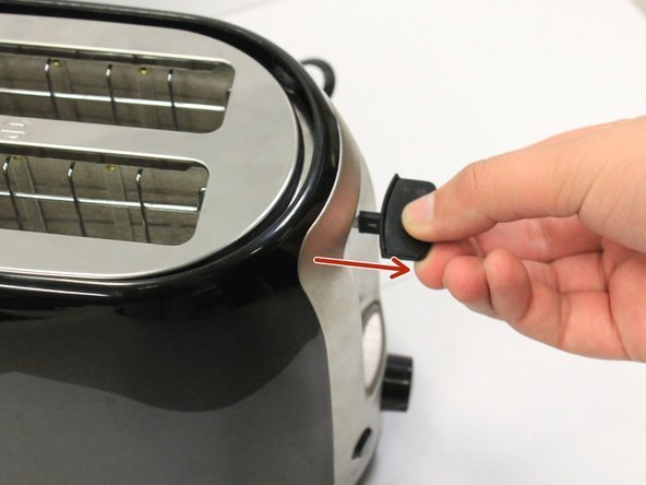 You will need to remove the toasting lever by removing the black tab from the lever.