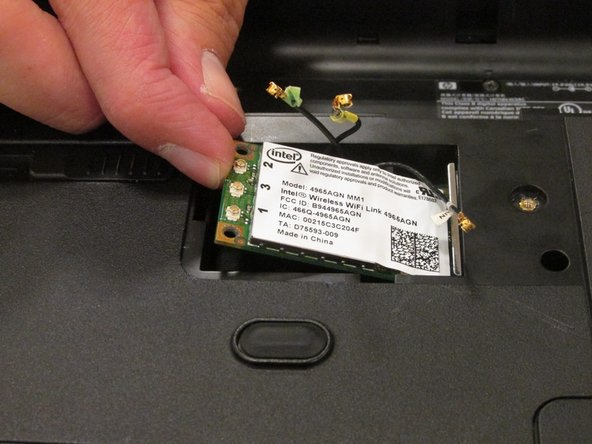 Gently pull out your wireless card from its top side to remove it from its holding.