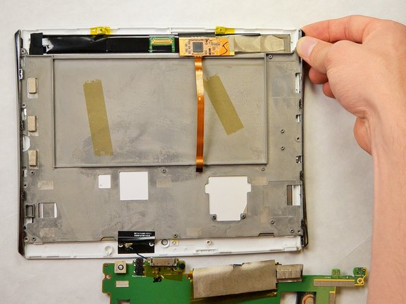 Take the gray backing off of the screen so that only the back of the LCD display is showing.