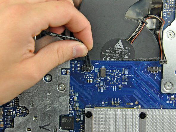 Disconnect the hard drive thermal sensor from the logic board by pulling its connector toward the top edge of the iMac.