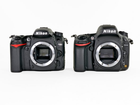 Image 1/2: Even without the different exterior markings, distinguishing the D600 from the D7000 is pretty easy once the body cap is removed, exposing the comparatively gigantic viewfinder mirror.