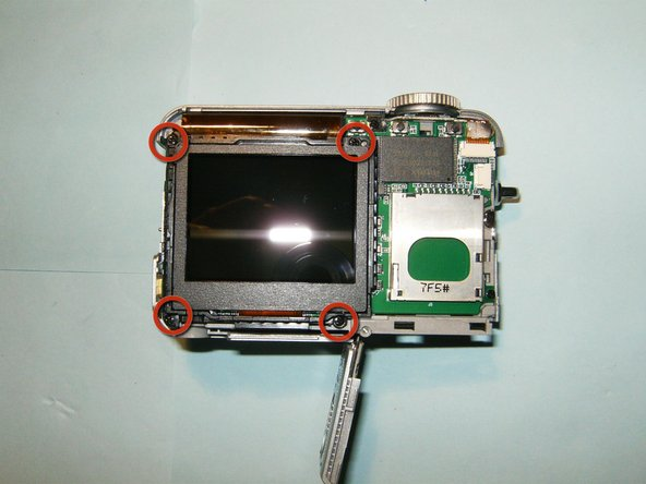 Image 3/3: Remove the four screws from the LCD.