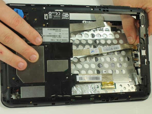 Once the back of the case is off, disconnect the wires by gently pulling on the plastic tabs as shown.
