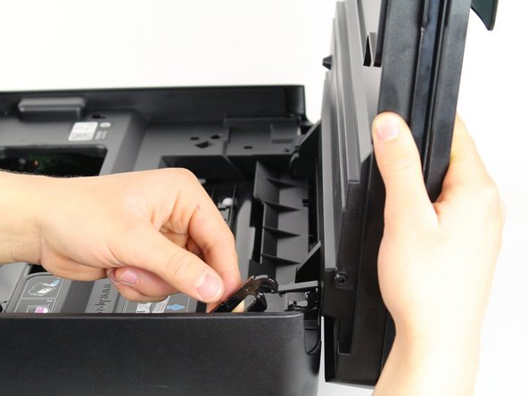 Remove the opening assist by  pushing it toward the front of the printer with a nylon spudger.
