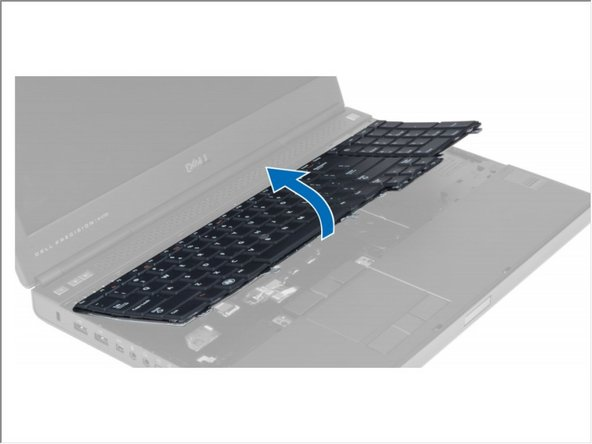 Starting from the bottom of the keyboard, separate the keyboard from the computer and flip the keyboard over.