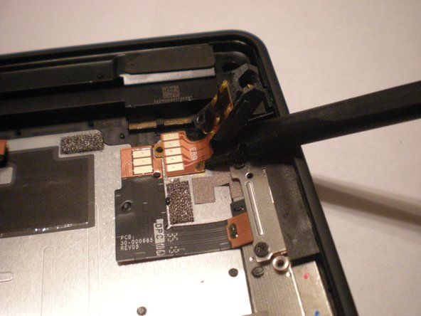 Image 2/3: Remove the silver T3 torx screw that is attaching headphone jack to the device