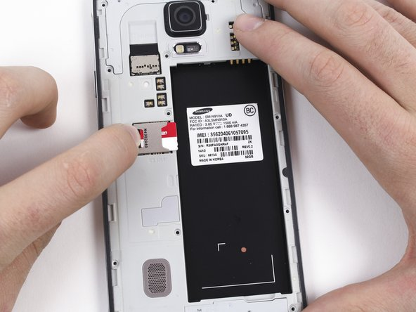 Remove the SIM card by first pushing the card slightly out of its housing, then pulling it the rest of the way.