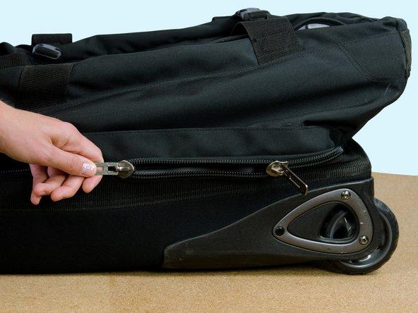Image 2/2: Unzip the main zipper.