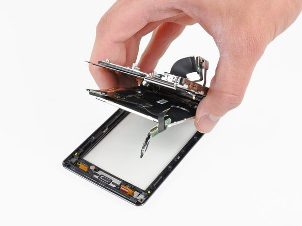 After disconnecting the digitizer ribbon cable and lifting out the earpiece, the front panel can be separated from the rest of the phone.
