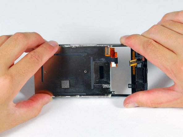 Separate the LCD and glass by sliding the LCD panel away from the ribbon cables on the glass.