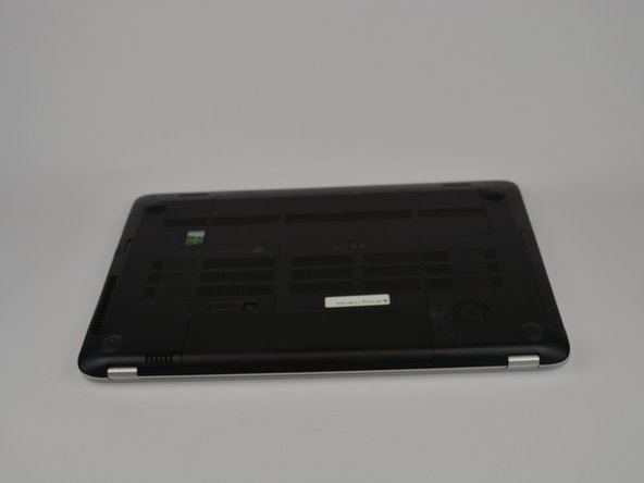 Lay the laptop with the battery facing towards you.