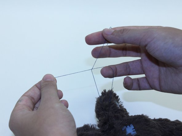 Cut the excess thread, leaving at least 4 inches to allow you to tie a double knot. This will close the seam.
