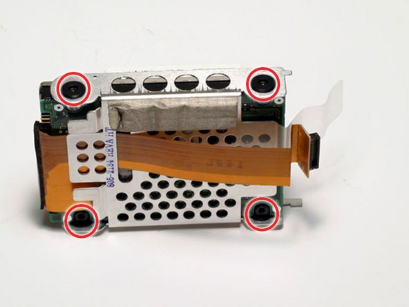 Remove the four black Torx screws located at the four corners of the hard drive bracket.