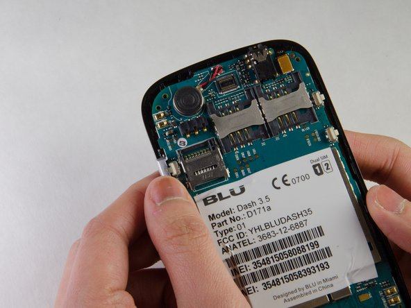 Remove volume and lock buttons by lifting them gently from the casing.