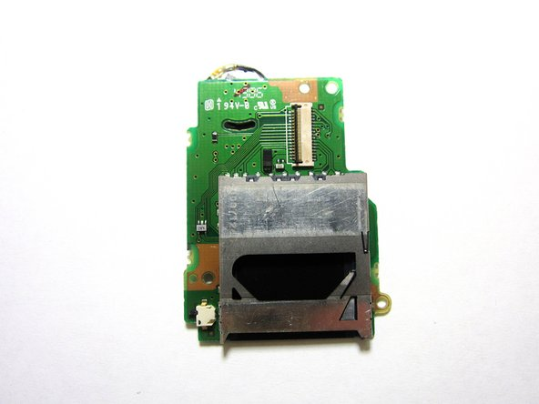 The SD card reader is attached to the back of the circuit board. The circuit board and SD card combination should be replaced.