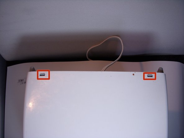 Image 1/1: Disconnect the small plastic clips on the back of the toaster.