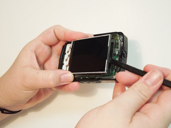 Carefully remove the screen from the silver casing using a prying tool or the black spudger