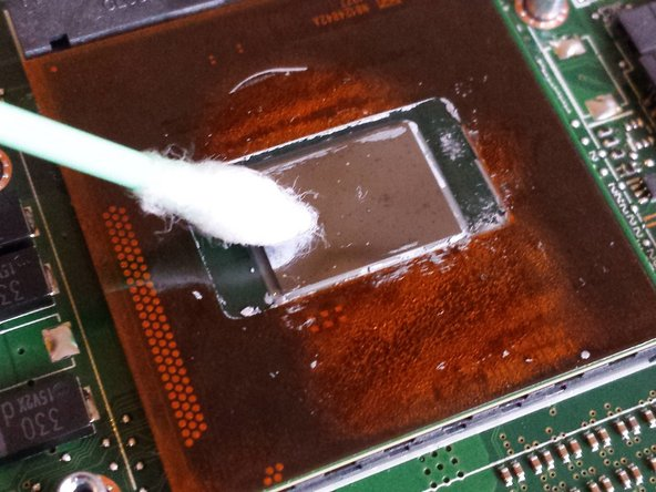 Use alcohol, q-tips and paper towel to completely remove the residual traces of thermal paste on the CPU.