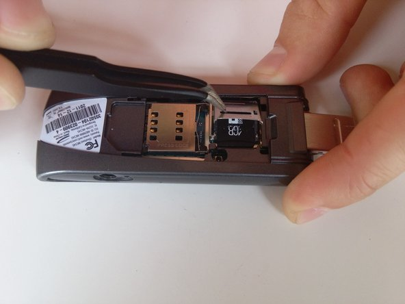 Lift the face plate and carefully remove the microSD card.