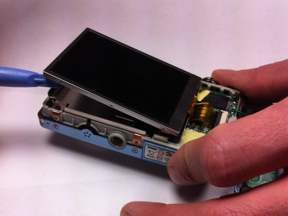 The LCD screen should now be disconnected from the rest of the camera and a pry tool can be used to lift it out of its casing.