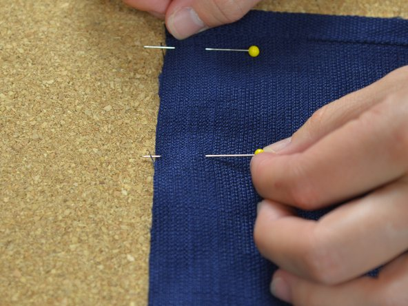 Work your way down the edge to be sewn, pining the two pieces of fabric together.